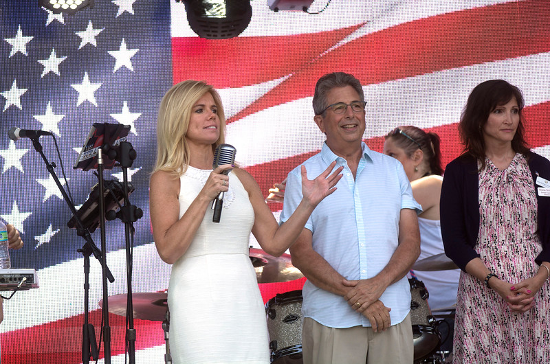 Kelly Yaede talks to the crowd at Hamilton's Independence Day festivities Monday.<br /> John Berry - The Trentonian