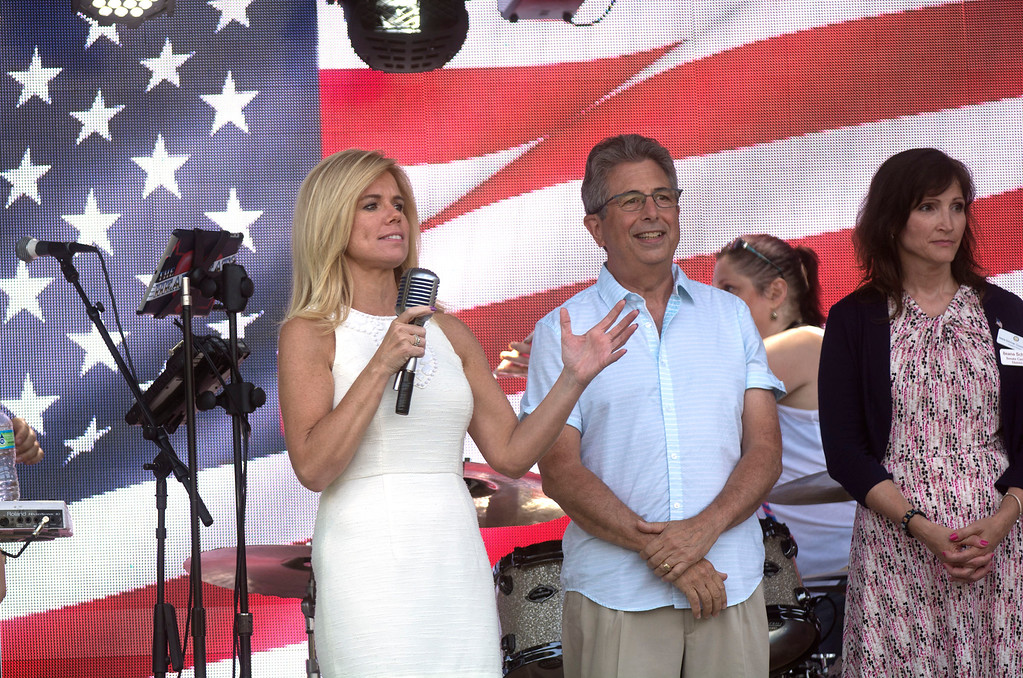 . Kelly Yaede talks to the crowd at Hamilton�s Independence Day festivities Monday.