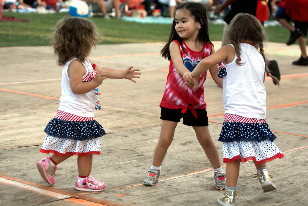 . Dancing while The Heartbeats perform at Hamilton�s Independence Day celebration are, l to r: Gabriella Casciano, 2, Lillian Barger, 4, and Adrianna Casciano, 4. 