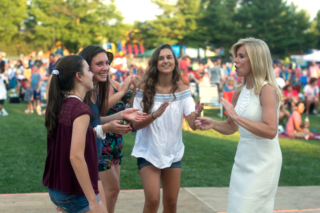 . Hamilton Mayor Kelly Yaede dances with some of the attendees at Hamilton�s Independence Day celebration at Veterans Park Monday evening. 