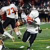 Hamilton`s Barry Ndeh picks up yardage against Lawrence. gregg slaboda photo