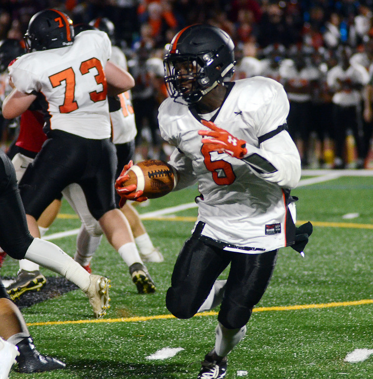 . Hamilton`s Barry Ndeh picks up yardage against Lawrence. gregg slaboda photo