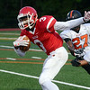 Lawrence`s Deon McLean on the run against Hamilton. gregg slaboda photo