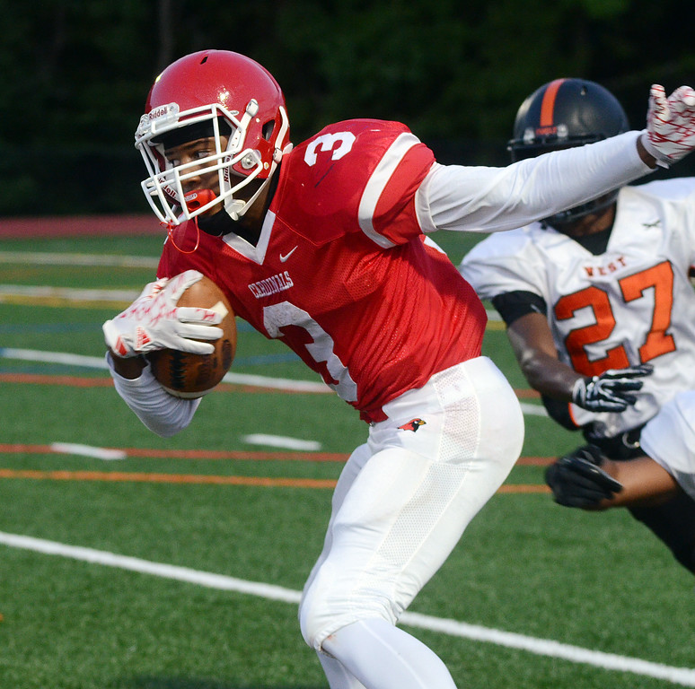 . Lawrence`s Deon McLean on the run against Hamilton. gregg slaboda photo