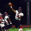 Hamilton`s QB Hezekiah Patterson throws a pass against Lawrence. gregg slaboda photo