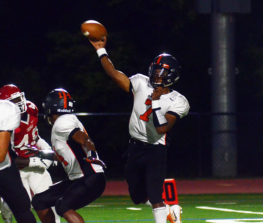 . Hamilton`s QB Hezekiah Patterson throws a pass against Lawrence. gregg slaboda photo