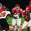 Lawrence`s Jacoby Sherard(c) picks up yardage against Hamilton. gregg slaboda photo