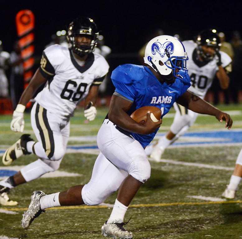 . Hightstown`s Johnny Andre carries the ball against Burlington Twp. gregg slaboda photo