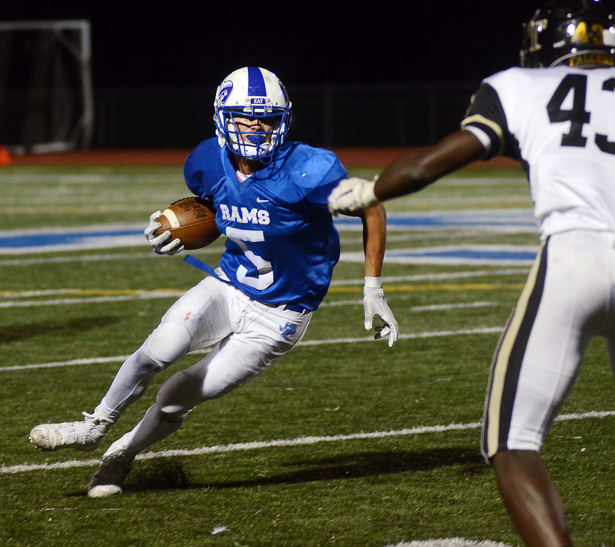 . Hightstown`s Michael Quigg(l)picks up yardage against Burlington Twp. gregg slaboda photo