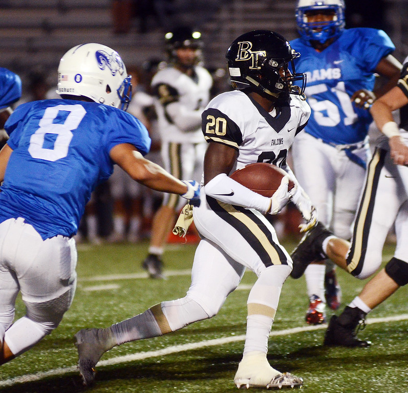 . Burlington Twp`s Justin Johnson(20)carries the ball against Hightstown. gregg slaboda photo