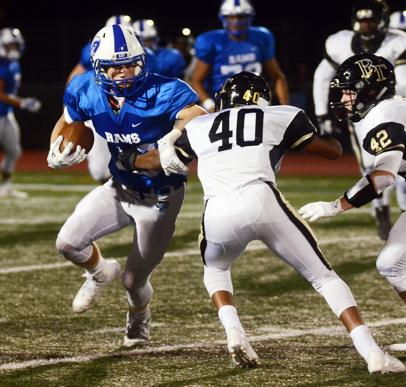 . Hightstown`s  Sean Haddock(l)runs the ball against Burlington Twp. gregg slaboda photo
