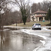 A Lower Makefield Township police officer makes his way around the flooded intersection of Ferry and River Roads as an ice jam on the Delaware river closed down roads on both sides of the river Monday morning as flooding and icy conditions made roads dangerous. <br /> John Berry - The Trentonian