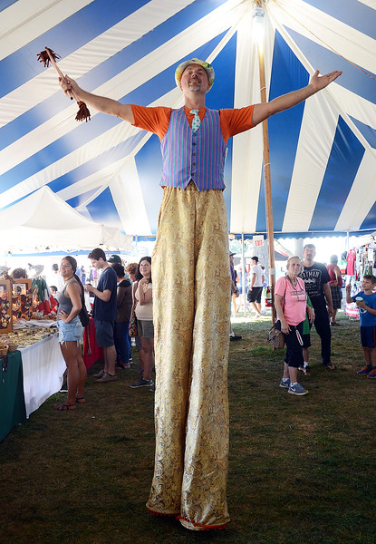 Stilt walker Khris Clayton entertains folks at the Italian-American Fetstival on Saturday. gregg slaboda photo