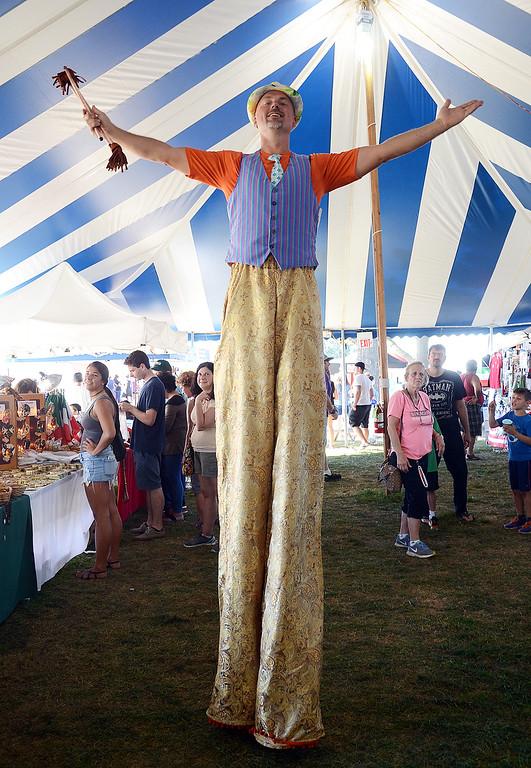 . Stilt walker Khris Clayton entertains folks at the Italian-American Fetstival on Saturday. gregg slaboda photo