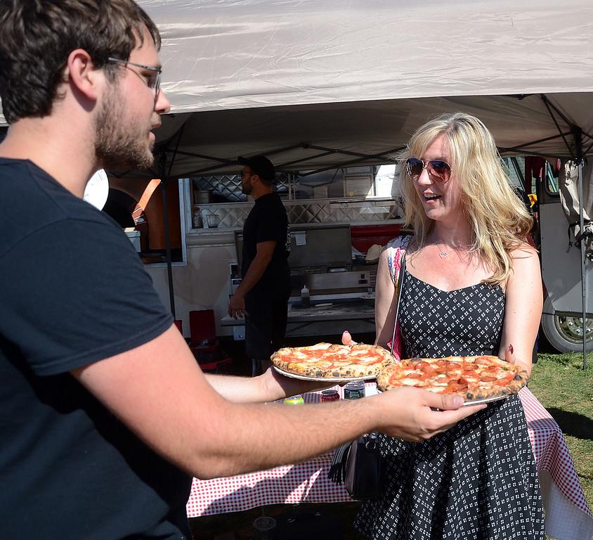 . Matt Michal(l)serves Chris Addeo her pizza at the Italian-American Festival at Mercer County Park on Saturday. gregg slaboda photo