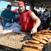 Chris Gresko cooks up some sausage and steak at the Italian-American Festival on Saturday. gregg slaboda photo