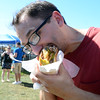 David Rivera chomps on a steak sandwich at the Italian-American Festival at Mercer County Park. gregg slaboda photo