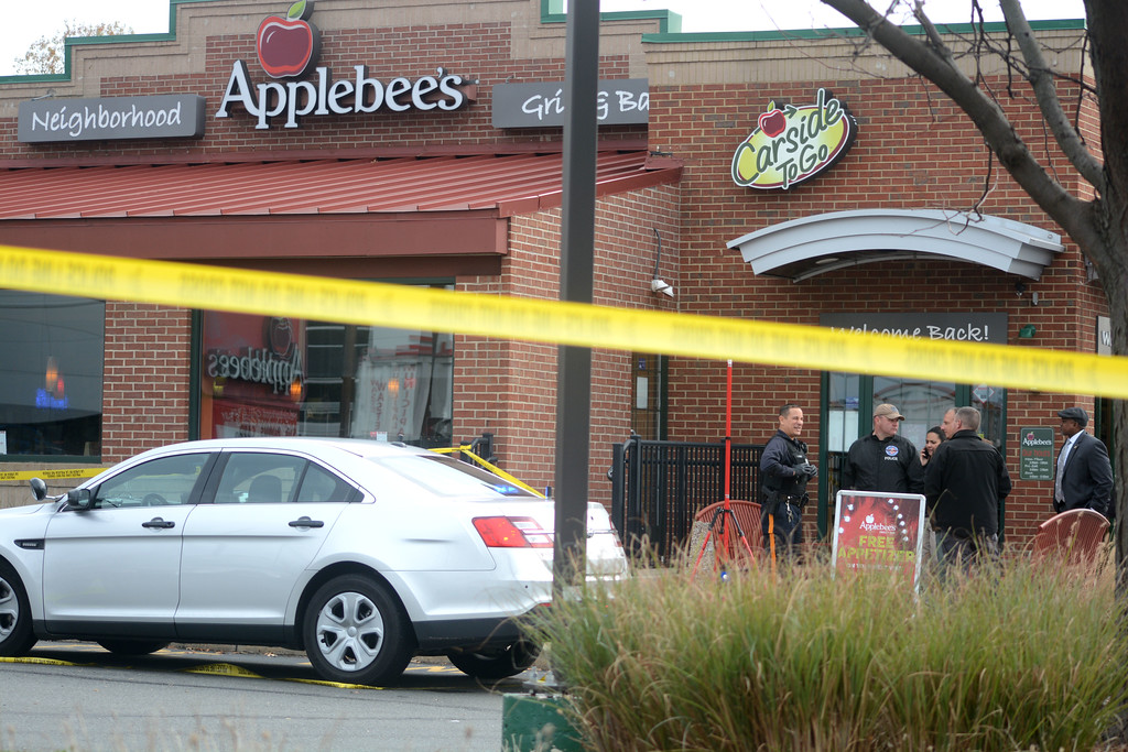 . Investigators outside the Applebee�s in Lawrence after a murder happened in the restaurant early Tuesday morning.