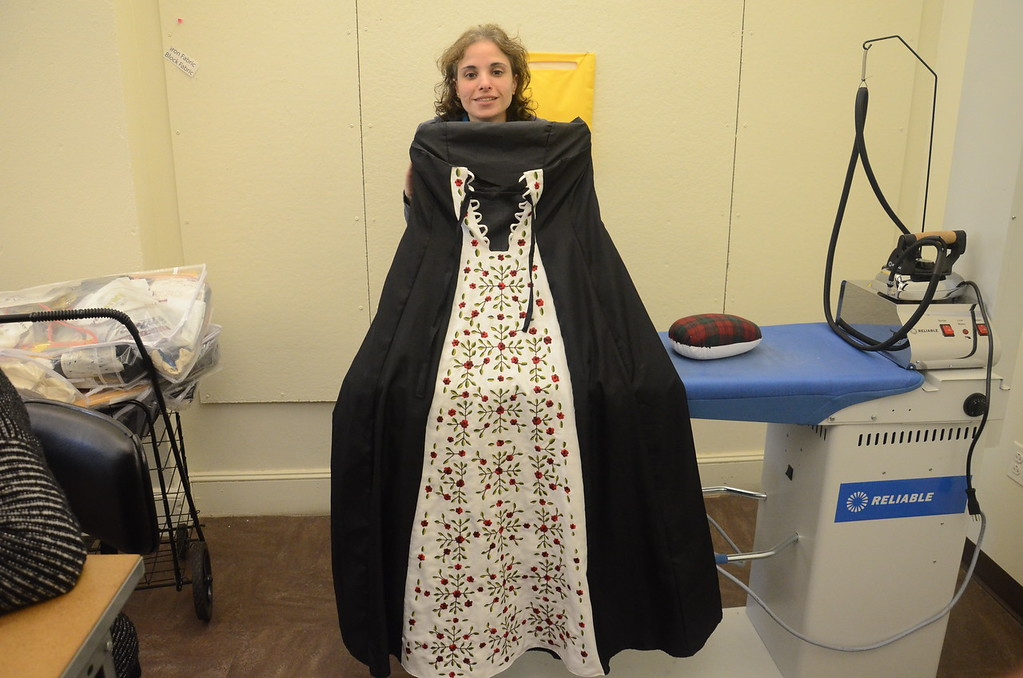 . Beth Dubrow, a Teaching Assistant at MCCC\'s Fashion Design program, shows off an embroidered evening dress she designed and sewed by hand. (Penny Ray - Trentonian)