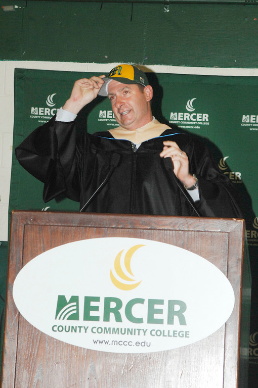 . Daniel Klim, executive director of the American Physical Therapy Association of New Jersey and a Mercer County Community College alumnus, trades the traditional graduation mortar board for his old MCCC baseball cap when giving the keynote address during the college�s 2018 Commencement Ceremony. Klim was a member of the 1996 Vikings baseball team that competed for the national championship.Courtesy of Mercer County Community College