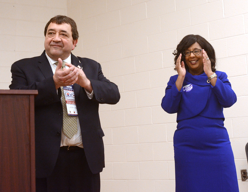 . Mercer County Freeholder Anthony Verrelli applauds as Verlina Reynolds-Jackson reacts to the announcement that she is the new State Assemblyperson for the 15th District. 