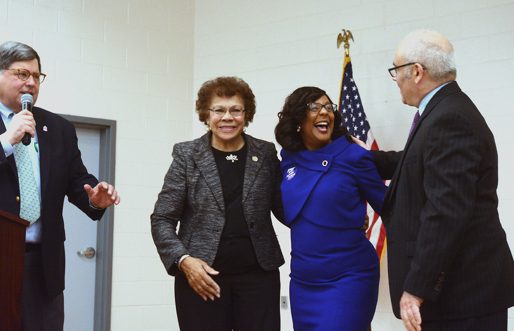 . State Senator Shirley Turner, Verlina Reynolds-Jackson and State Assemblyperson Reed Guscioracelebrate together as Democrats selected Reynolds-Jackson to fill the 15th District Assembly seat vacated by Liz Muoio. Arthur Sypek Jr., left, makes the announcement. 