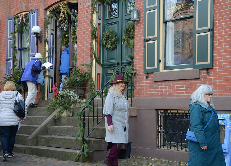 People walk along Mercer st during the 51st Annual Mill Hill Holiday House Tour on Saturday. gregg slaboda photo
