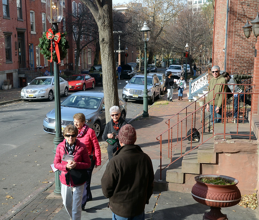 . People walk along  Mercer st during the 51st Annual Mill Hill Holiday House Tour. gregg slaboda photo