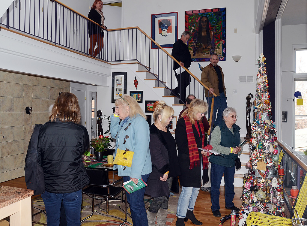 . People tour a house on Mercer St during the 51st Annual Mill Hill Holiday House Tour on Saturday. greg slaboda photo