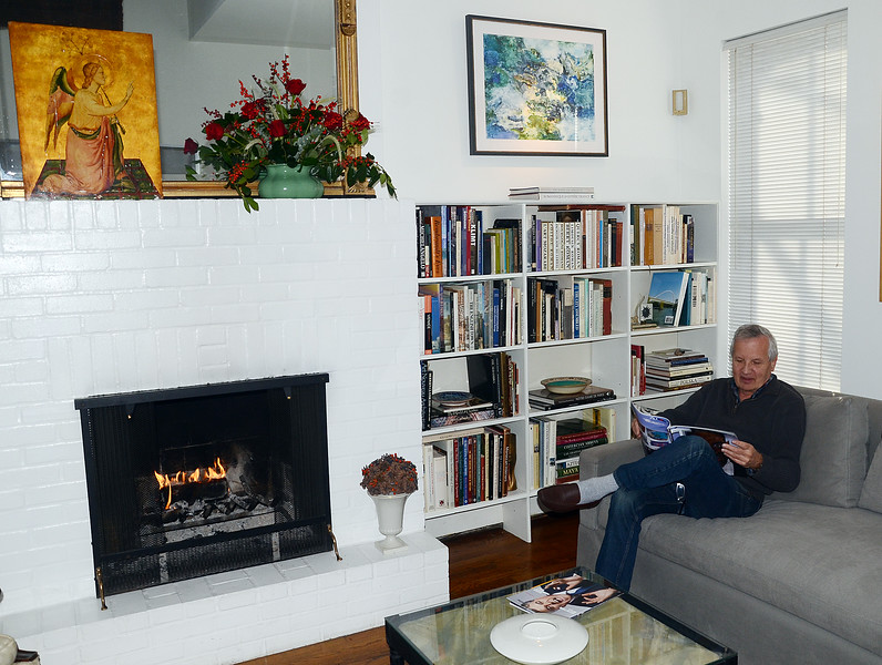 Homeowner Joe Ozga relaxes  in his Mercer st house during the 51st annual Mill Hill Holiday House Tour on Saturday. gregg slaboda photo