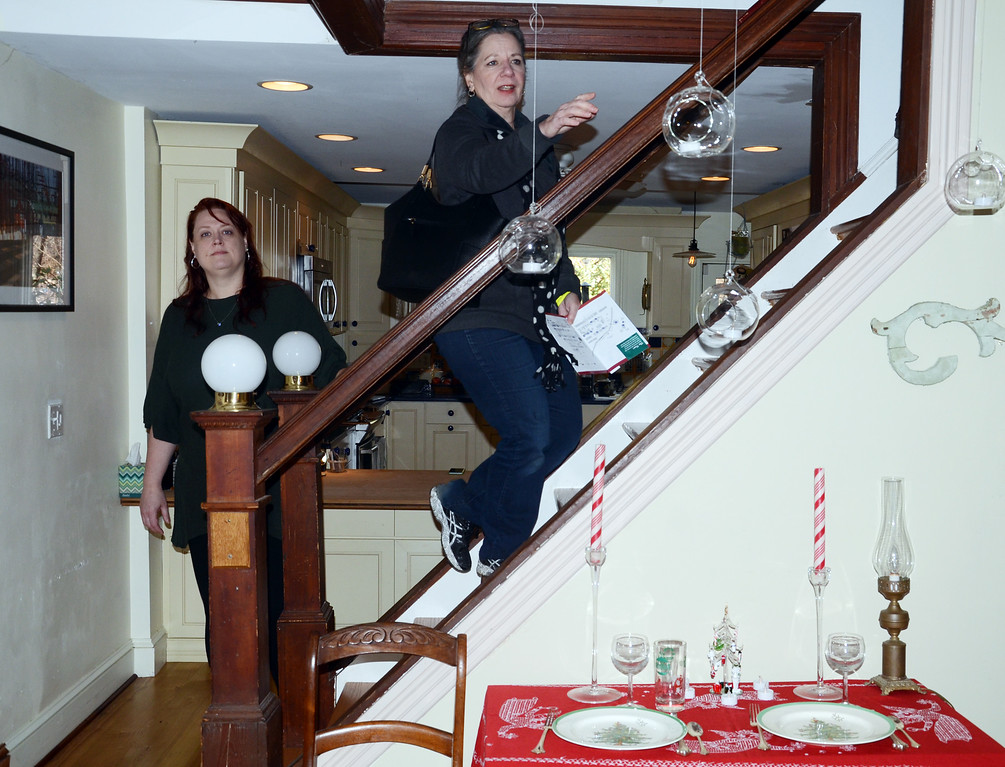 . People walk through a home during the 51st Annual Mill Hill Hoiliday House Tour on Saturday. gregg slaboda photo