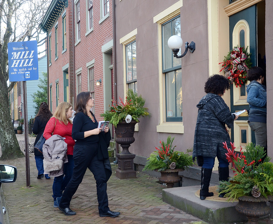 . People walk along Jackson st during the 51st Annual Mill Hill Holiday House Tour on Saturday. gregg slaboda photo