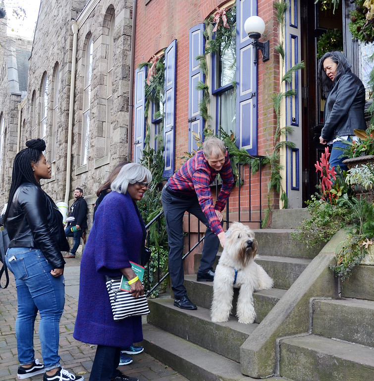 . David Henderson with his dog Lightning greets people outside his Mercer st house during the 51st Annual  Mill Hill Holiday House Tour on Saturday. gregg slaboda photo