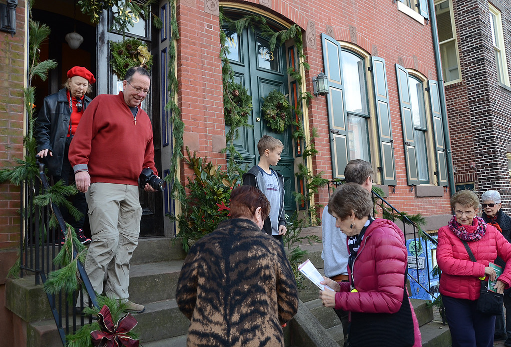 . People tour a house during the 51st Annual Mill Hill Hoiiday House Tour on Saturday. gregg slaboda photo
