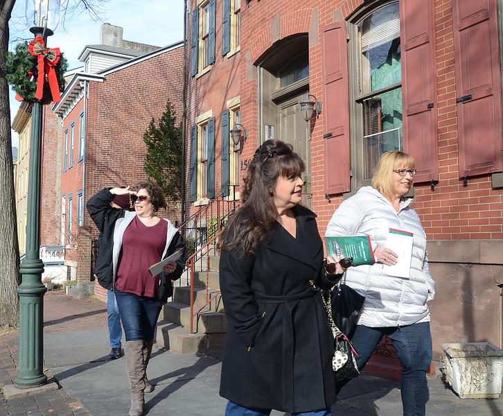 Suzanne Barnes(l)and Cecilia Tromp(r)walk along Mercer St during the 51st Annual Mill Hill Holiday House Tour . gregg slaboda photo