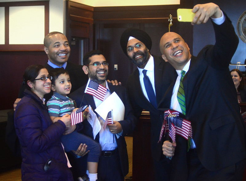 New Jersey Senator Cory Booker takes a photo with new American citizens, the Appala family of West Windsor, after a naturalization ceremony at the Federal Courthouse in Trenton. <br /> Left to right: Sailaja Appala, Vaibhay Appala, 3, Judge Michael A. Shipp who officiated the ceremony, Ravi Appala, Attorney General of NJ Gurbir Grewal, and Booker. <br /> John Berry - The Trentonian