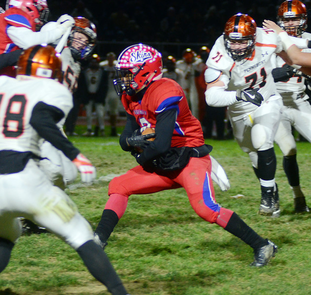 Neshaminy`s Joel Stills(c) carries the ball against Pennsbury. gregg slaboda photo