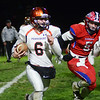 Pennsbury`s Zach Demarchis(l)gains yardage as Neshaminy`s Oleh Manzyk(r) looks to make the tackle. gregg slaboda photo