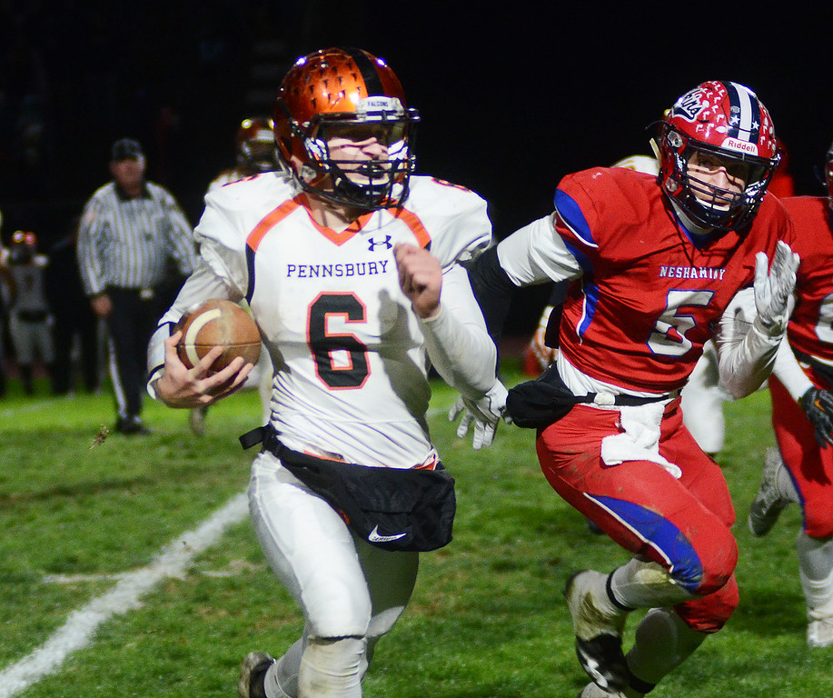 . Pennsbury`s Zach Demarchis(l)gains yardage as Neshaminy`s Oleh Manzyk(r) looks to make the tackle. gregg slaboda photo