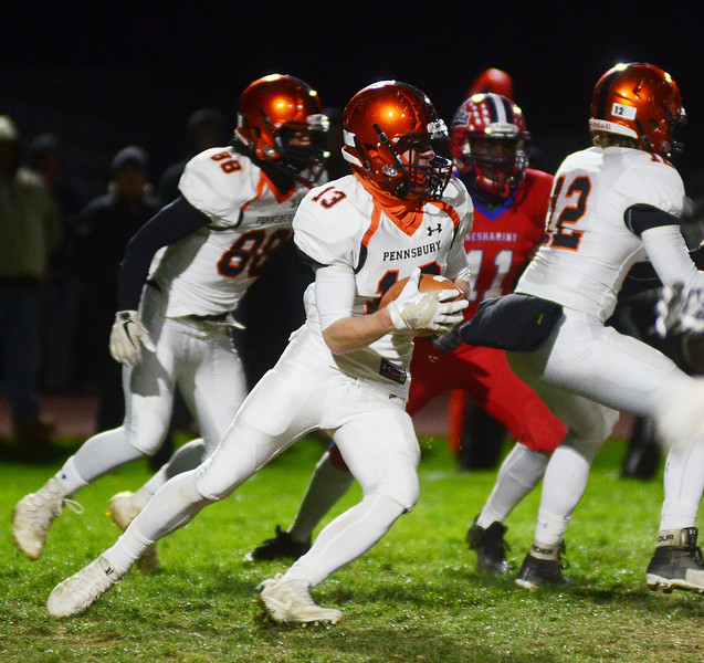 Pennsbury`s Jason Cook(c)carries the ball against Neshaminy. gregg slaboda photo