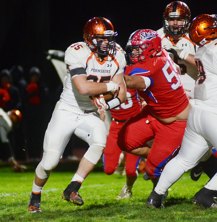 . Pennsbury`s Andrew Basalyga(l) carries the ball against Neshaminy. gregg slaboda photo