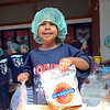 Kiran Bajnath,21/2 years old, helps package meals for 100,000 families at the One Project event at Robbinsville High School on Saturday morning . gregg slabopda photo