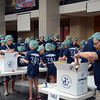 One Project  workers package meals for 100,000 families  on Saturday at Robbinsville High School. gregg slaboda photo