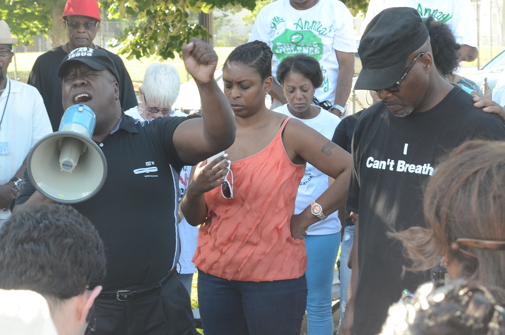 . Citizens prayed at the Trenton Battle Monument Monday before marching through the city promoting peace and calling for an end to police brutality. (Penny Ray - Trentonian)