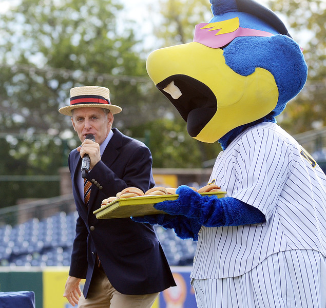 Competitive eating Master of Ceremonies George Shea (l) watches Thunder Thunder mascot Boomer carry a tray of porkroll sandwiches. gregg slaboda photo