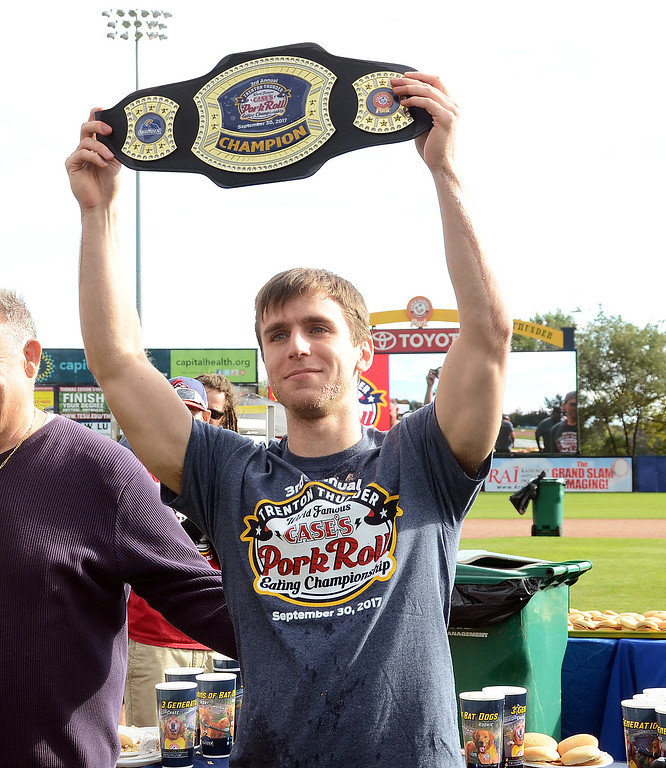 . Carmen Cincotti holds up the winners belt  after he won the Trenton Thunder Case`s Pork Roll Eating Championship on Saturday at Arm&Hammer Park. Cincotti consumed  40 pork roll sandwichs in 10 minutes. World Champion Joey Chestnut did not attend the event. gregg slaboda photo