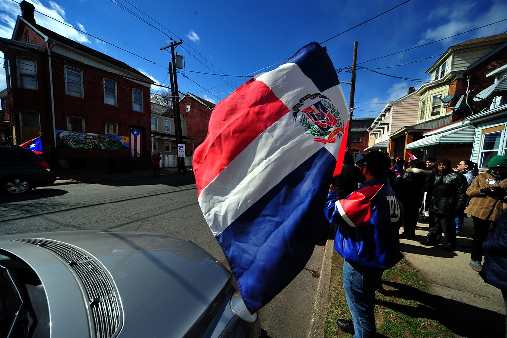 . Flags wave at a Saturday event honoring the efforts of the city\'s Puerto Rican community following the spraying of a swastika on a Puerto Rican flag that was painted on a building in the 100 block of Genesee Street . (Scott Ketterer - The Trentonian)