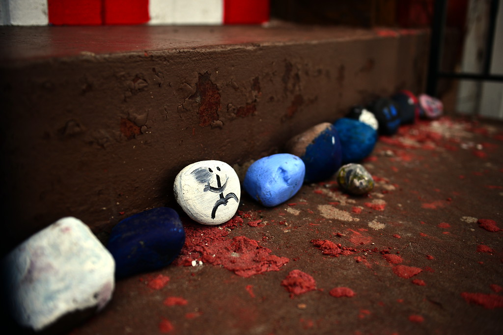 . Painted rocks are seen  at a Saturday event honoring the efforts of the city\'s Puerto Rican community following the spraying of a swastika on a Puerto Rican flag that was painted on a building in the 100 block of Genesee Street . (Scott Ketterer - The Trentonian)