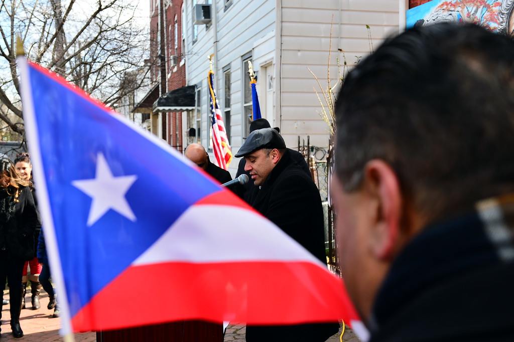 . Pastor Barry Vazquez leads a prayer at a peace rally in Trenton on Saturday March 4, 2017. (Scott Ketterer - The Trentonian)