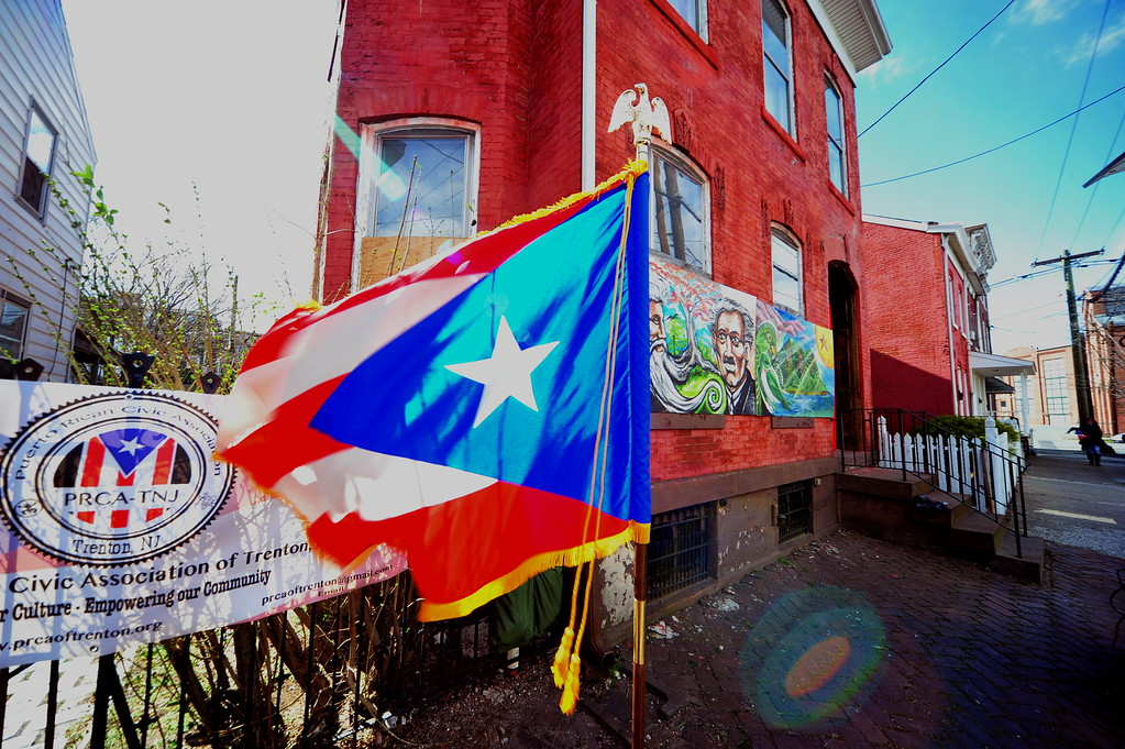 . A Puerto Rican flag is seen waving  at a Saturday event honoring the efforts of the city\'s Puerto Rican community following the spraying of a swastika on a Puerto Rican flag that was painted on a building in the 100 block of Genesee Street . (Scott Ketterer - The Trentonian)